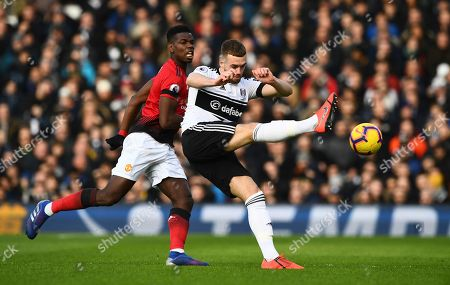 Paul Pogba of Manchester United and Calum Chambers of Fulham