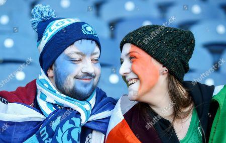 Scotland vs Ireland. Scotland fan Frazer Grant with Ireland fan Sarah Greene