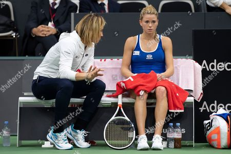 Italy's Camila Giorgi (R) speaks with Italy's captain Tathiana Garbin during her match against Switzerland's Viktorija Golubic at the Fed Cup world group II, first round tie, between Switzerland and Italy in the Swiss Tennis Arena in Biel, Switzerland, 09 February 2019.