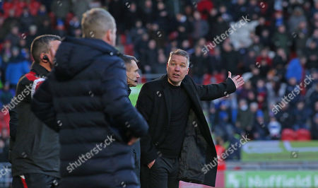 Peterborough United Manager Darren Ferguson argues with Doncaster Rovers manager Grant McCann after the third goal