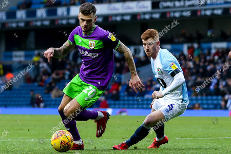 Stock Photo of Jamie Paterson of Bristol City takes on Harrison Reed of Blackburn Rovers