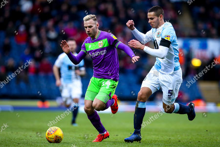 Andreas Weimann of Bristol City takes on Jack Rodwell of Blackburn Rovers