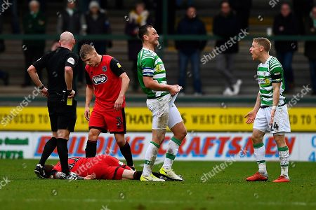 Gary Warren of Yeovil Town middle shows his frustration after Craig Alcock of Yeovil Town right received a red cardduring Yeovil Town vs Grimsby Town, Sky Bet EFL League 2 Football at Huish Park on 9th February 2019