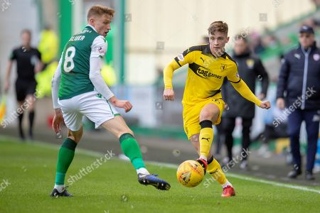 Nathan Flanagan (#16) of Raith Rovers FC plays the ball past Vykintas Slivka (#8) of Hibernian FC during the William Hill Scottish Cup match between Hibernian FC and Raith Rovers FC at Easter Road Stadium, Edinburgh