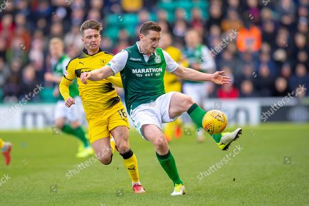 Paul Hanlon (#4) of Hibernian FC gets to the ball ahead of Nathan Flanagan (#16) of Raith Rovers FC during the William Hill Scottish Cup match between Hibernian FC and Raith Rovers FC at Easter Road Stadium, Edinburgh