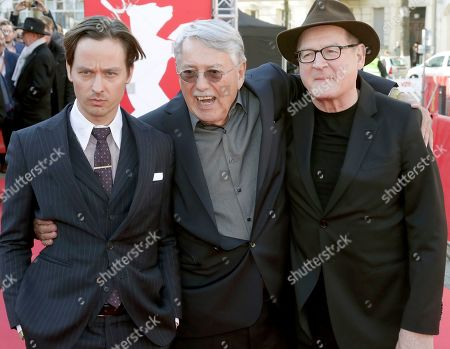 From left, actor Tom Schilling, director Heinrich Breloer and actor Burghart Klaussner pose for the media on the red carpet for the film 'Brecht' at the 2019 Berlinale Film Festival in Berlin, Germany