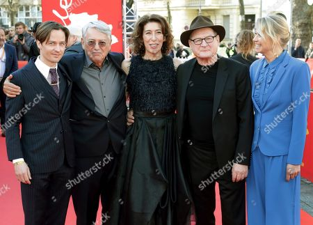 From left, actor Tom Schilling, director Heinrich Breloer, actress Adele Neuhauser, actor Burghart Klaussner and actress Trine Dyrholm pose for the media on the red carpet for the film 'Brecht' at the 2019 Berlinale Film Festival in Berlin, Germany