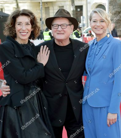 From left, actress Adele Neuhauser, actor Burghart Klaussner and actress Trine Dyrholm pose for the media on the red carpet for the film 'Brecht' at the 2019 Berlinale Film Festival in Berlin, Germany