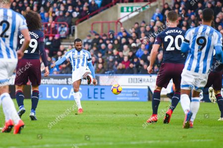 Jason Puncheon of Huddersfield Town (42) shoots during the Premier League match between Huddersfield Town and Arsenal at the John Smiths Stadium, Huddersfield