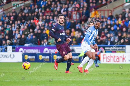 Jason Puncheon of Huddersfield Town (42) passes the ball away from Sead Kolasinac of Arsenal (31) during the Premier League match between Huddersfield Town and Arsenal at the John Smiths Stadium, Huddersfield