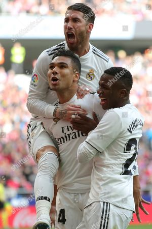 Real Madrid's Carlos Henrique Casimiro (L) celebrates after scoring the 0-1 lead during a Spanish LaLiga soccer match between Atletico Madrid and Real Madrid at the Wanda Metropolitano stadium in Madrid, Spain, 09 February 2019.