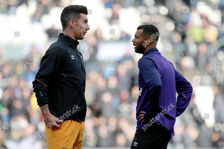 Derby County defender Ashley Cole and Hull City defender Liam Ridgewell share a conversation ahead of the EFL Sky Bet Championship match between Derby County and Hull City at the Pride Park, Derby