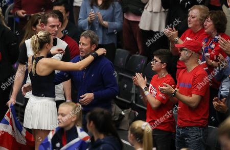 Katie Boulter hugs her coach Jeremy Bates after defeating Ivana Jorovic of Serbia in the opening singles best-of-three tie