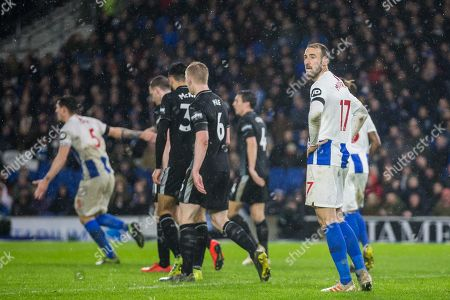 Glenn Murphy (Brighton) looking over at Stuart Attwell (Referee) during the Premier League match between Brighton and Hove Albion and Burnley at the American Express Community Stadium, Brighton and Hove