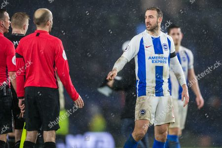 Stock Picture of Glenn Murphy (Brighton) talking with Stuart Attwell (Referee) at the end of the game during the Premier League match between Brighton and Hove Albion and Burnley at the American Express Community Stadium, Brighton and Hove