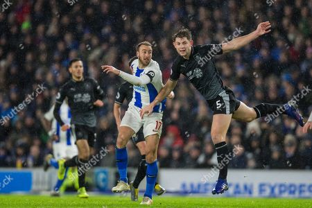 Stock Photo of Glenn Murphy (Brighton) & James Tarkowski (Burnley) during the Premier League match between Brighton and Hove Albion and Burnley at the American Express Community Stadium, Brighton and Hove