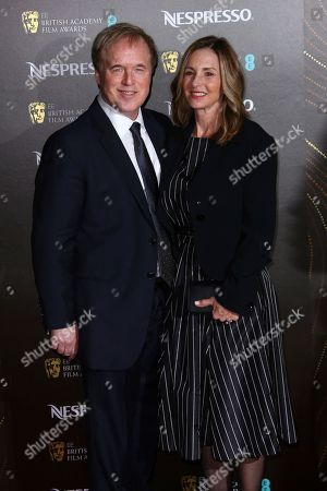 Brad Bird poses for photographers upon arrival at the BAFTA Nominees Party in London