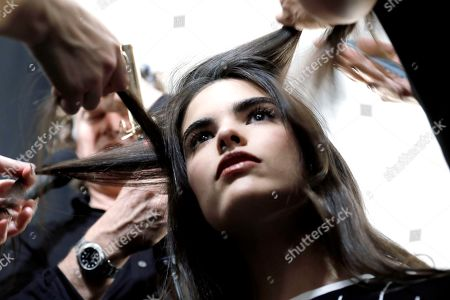 A model has her hair done backstage before the Taoray Wang fashion show during New York Fashion Week in New York, New York, 09 February 2019. New York Fashion Week for designer's autumn and winter lines is being held from 06 to 13 February 2019.