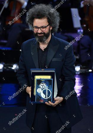 Simone Cristicchi receives the 'Sergio Endrigo' award from Claudio Baglioni on stage during the 69th Sanremo Italian Song Festival at the Ariston theatre in Sanremo, Italy, 09 February 2019. The festival runs from 05 to 09 February.