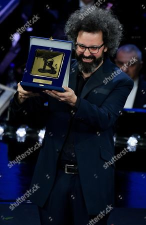 Simone Cristicchi poses with the Giancarlo Bigazzi award for musical composition on stage during the 69th Sanremo Italian Song Festival at the Ariston theatre in Sanremo, Italy, 09 February 2019. The festival runs from 05 to 09 February.