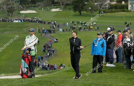 Stock Photo of Kira Kazantsev follows her approach shot to the sixth green of the Pebble Beach Golf Links during the third round of the AT&T Pebble Beach Pro-Am golf tournament, in Pebble Beach, Calif
