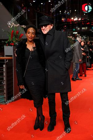 Stock Image of Marius Mueller-Westernhagen (R) with wife Lindiwe Suttle (L) arrive for the premiere of 'The Golden Glove' (Der Goldene Handschuh) during the 69th annual Berlin Film Festival, in Berlin, Germany, 09 February 2019. The movie is presented in the Official Competition at the Berlinale that runs from 07 to 17 February.