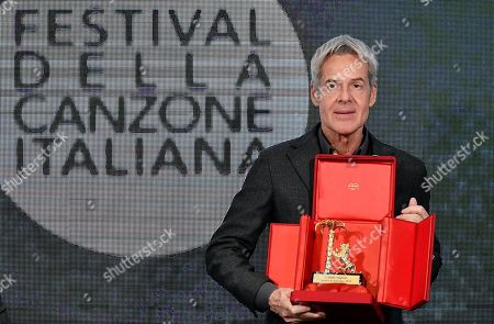 Italian singer and Sanremo Festival artistic director Claudio Baglioni poses with the 'Amico di Sanremo' award during the final press conference of the 69th Sanremo Italian Song Festival, in Sanremo, Italy, 10 February 2019. The festival was running from 05 to late 09 February 2019 evening.