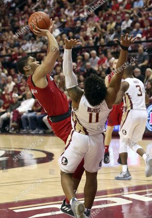 Louisville's Christen Cunningham, left, is fouled by Florida State's David Nichols (11) while trying to shoot in an NCAA college basketball game, in Tallahassee, Fla