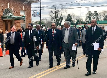 From left, Mayor Lancer Shull, Rep. Jerry Govan, Robert Young, Donald Day and Dr. Bobby Donaldson walk from the private ceremony to the 'Blinding of Isaac Woodard' historical marker dedication in Batesburg-Leesville, S.C., on . The marker is located at the site of the old police station where the beating occurred