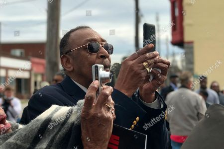 Stock Photo of Sgt. Isaac Woodards nephew, Robert Young, takes a picture of the Blinding of Isaac Woodard historical marker in Batesburg-Leesville, S.C., on