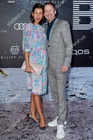 Wotan Wilke Moehring (R) and his partner Cosima Lohse (L) pose on the 'black carpet' of the 'Place to B' party during the 69th annual Berlin Film Festival, in Berlin, Germany, 09 February 2019. The party of German tabloid newspaper BILD under the motto 'Space Night' took place during the Berlinale that runs from 07 to 17 February 2019.