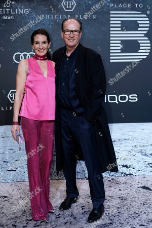 Stock Photo of Herbert Knaup (R) and his spouse Christiane (L) pose on the 'black carpet' of the 'Place to B' party during the 69th annual Berlin Film Festival, in Berlin, Germany, 09 February 2019. The party of German tabloid newspaper BILD under the motto 'Space Night' took place during the Berlinale that runs from 07 to 17 February 2019.