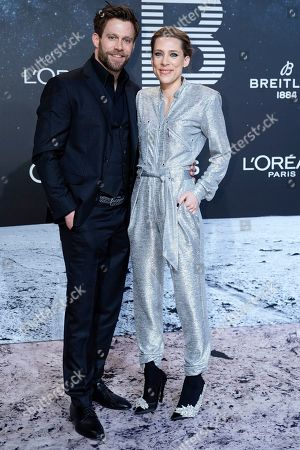 Stock Image of German actor Ken Duken (L) and his spouse, German actress Marisa Leonie Bach (R) pose on the 'black carpet' of the 'Place to B' party during the 69th annual Berlin Film Festival, in Berlin, Germany, 09 February 2019. The party of German tabloid newspaper BILD under the motto 'Space Night' took place during the Berlinale that runs from 07 to 17 February 2019.