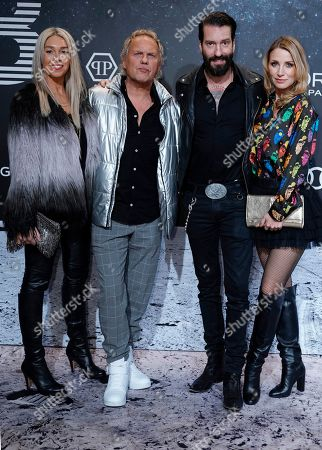 Uwe Ochsenknecht (2-L), his wife Kiki Viebrock (L) and Alec Voelkel (2-R) aka Boss Burns of the German band 'The Boss Hoss' with his wife Johanna Michels (R) on the 'black carpet' of the 'Place to B' party during the 69th annual Berlin Film Festival, in Berlin, Germany, 09 February 2019. The party of German tabloid newspaper BILD under the motto 'Space Night' took place during the Berlinale that runs from 07 to 17 February 2019.