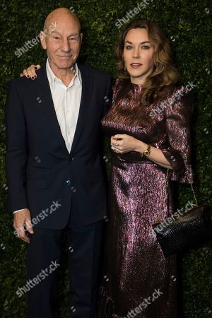 Patrick Stewart, Sunny Ozell. Sir Patrick Stewart and Sunny Ozell pose for photographers upon arrival at the Finch Chanel Pre BAFTAs Dinner in London