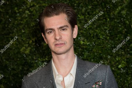 Andrew Garfield poses for photographers upon arrival at the Finch Chanel Pre BAFTAs Dinner in London
