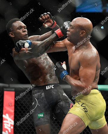 Nigeria's Israel Adesanya, left, and Brazil's Anderson Silva fight during their middlewesight bout at the UFC 234 event in Melbourne, Australia