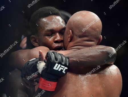 Israel Adesanya, Anderson Silva. Nigeria's Israel Adesanya, left, hugs Brazil's Anderson Silva after winning their middlewesight bout at the UFC 234 event in Melbourne, Australia