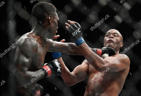 Nigeria's Israel Adesanya, left, and Brazil's Anderson Silva fight during their middleweight bout at the UFC 234 event in Melbourne, Australia