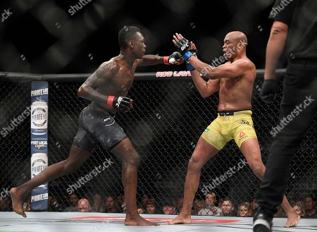 Anderson Silva, Israel Adesanya. Nigeria's Israel Adesanya, left, and Brazil's Anderson Silva fight during their middleweight bout at the UFC 234 event in Melbourne, Australia