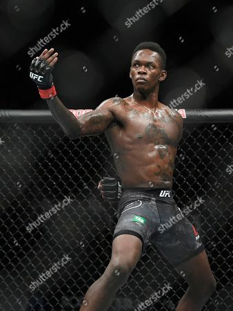 Nigeria's Israel Adesanya poses as he fights Brazil's Anderson Silva in their middleweight bout at the UFC 234 event in Melbourne, Australia