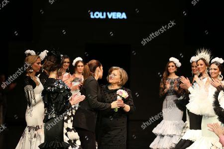 Designer Loli Vera and SIMOF Raquel Revuelta on the catwalk