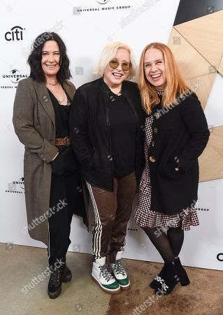 Kathy Valentine, Gina Schock, Charlotte Caffey. Kathy Valentine, from left, Gina Schock and Charlotte Caffey, members of The Go-Go's, attend Sir Lucian Grainge's 2019 Artist Showcase Presented by Citi on in Los Angeles