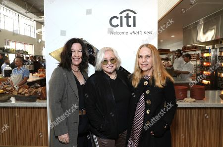 Stock Picture of Kathy Valentine, Gina Schock, Charlotte Caffey. Kathy Valentine, from left, Gina Schock and Charlotte Caffey, Members of The Go-Go's, attend Sir Lucian Grainge's 2019 Artist Showcase Presented by Citi on in Los Angeles