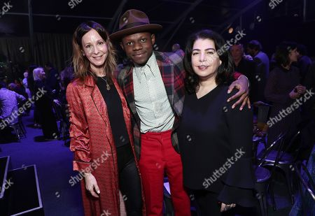 Jody Gerson, J.S. Ondara, Michele Anthony. Jody Gerson, CEO of Universal Music Publishing Group, from left, J.S. Ondara and Michele Anthony, EVP of Universal Music Group, attend Sir Lucian Grainge's 2019 Artist Showcase Presented by Citi on in Los Angeles