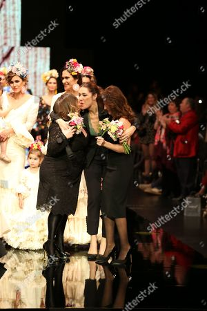 Sonibel designers Sonia and Isabel with Raquel Revuelta on the catwalk