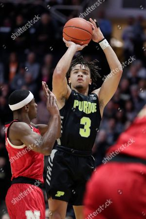 Glynn Watson Jr., Carsen Edwards. Purdue guard Carsen Edwards (3) shoots over Nebraska guard Glynn Watson Jr. (5) during the first half of an NCAA college basketball game in West Lafayette, Ind