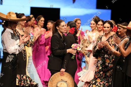 Designer Pilar Rubio and Raquel Revuelta on the catwalk