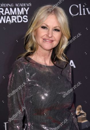 Mindi Abair arrives at Pre-Grammy Gala And Salute To Industry Icons at the Beverly Hilton Hotel, in Beverly Hills, Calif