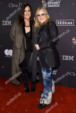 Melissa Etheridge, Linda Wallem. Melissa Etheridge, right, and Linda Wallem arrive at the Pre-Grammy Gala And Salute To Industry Icons at the Beverly Hilton Hotel, in Beverly Hills, Calif
